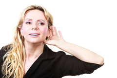 Blonde woman making listening gesture Stock Photos