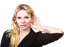 Blonde woman making listening gesture Royalty Free Stock Photography
