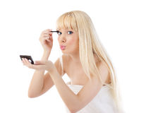 Blonde woman making make up around the eyes Royalty Free Stock Photos