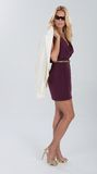 Blonde woman in maroon dress. Royalty Free Stock Image