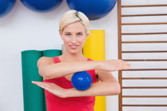 Blonde woman with massage ball Stock Photography