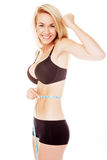 Blonde woman measuring her stomache. Happy blonde woman measuring her waist on white Stock Photo