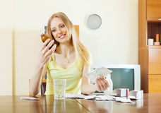 Blonde woman with medications Royalty Free Stock Photography