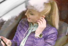Blonde woman with mobile phone Stock Photography