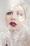 Blonde woman model wrapped in plastic Royalty Free Stock Images