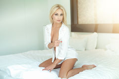 Blonde woman at the morning. Royalty Free Stock Image