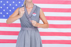 Blonde woman motivating for electoral campaign. Composite image of blonde woman motivating for electoral campaign Stock Photos