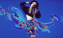 Blonde woman in multi skirt with multi digital abstract. On blue background Stock Images