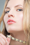Blonde woman with necklace Royalty Free Stock Photos