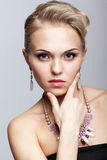 Blonde woman with necklace Royalty Free Stock Photography