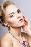 Blonde woman with necklace Stock Image