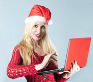 Blonde woman in a New Year's hat Royalty Free Stock Image