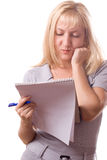 Blonde woman with note pad. Isolated. #10. Blonde woman with note pad and a pen, thinking. Isolated on white. #10 stock photography