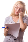 Blonde woman with note pad. Isolated. #11. Blonde woman with note pad and a pen, thinking. Isolated on white. #11 stock image