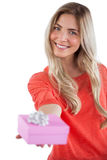 Blonde woman offering a present Royalty Free Stock Images