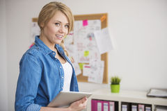 Blonde woman in the office Royalty Free Stock Photos