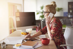 Blonde woman in office Stock Image