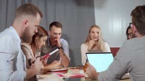 Blonde woman office worker is performing at working meeting stock footage