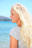 Blonde woman outdoors on beach Royalty Free Stock Image