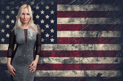 Blonde woman over Grunge USA Flag background Royalty Free Stock Photo