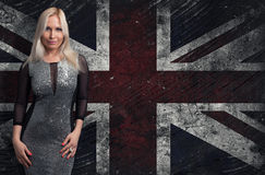Blonde woman over Grungy UK Flag Stock Photo