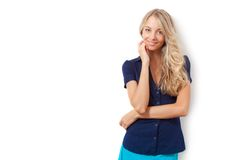 Blonde woman over white wall Royalty Free Stock Photos