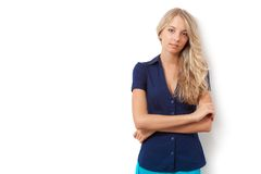 Blonde woman over white wall Stock Images