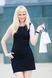 Blonde  woman  with pack shopping Stock Image