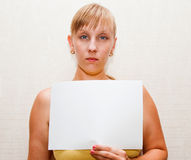 Blonde woman with A4 paper. Blonde woman with wihte A4 paper in  hand Stock Photography