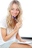Blonde woman with pen and notepad Stock Photo