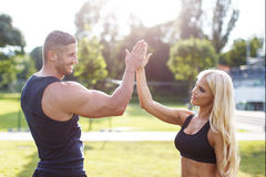 Blonde woman with personal trainer give high five Royalty Free Stock Images