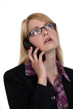 Blonde woman on the phone Royalty Free Stock Photography