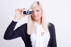 Blonde woman photographing Stock Image