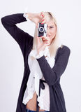 Blonde woman photographing Royalty Free Stock Photo