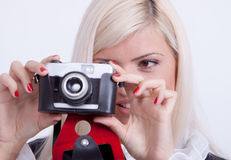 Blonde woman photographing Stock Photos