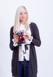 Blonde woman photographing Stock Images