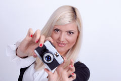 Blonde woman photographing Royalty Free Stock Photography