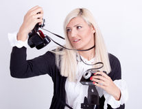 Blonde woman photographing Royalty Free Stock Image