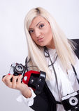 Blonde woman photographing Royalty Free Stock Images