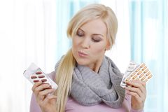 Blonde woman with pills Stock Photos