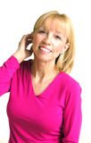 Blonde Woman in Pink. Portrait of a pretty, smiling, blonde haired woman in a long sleeved pink shirt stock photos