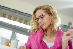 Blonde woman in pink bathrobe Stock Photography