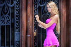 Blonde woman in pink dress. Royalty Free Stock Image