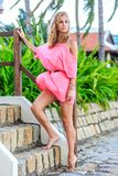 Blonde Woman In Pink Dress Posing In The Park Royalty Free Stock Photography