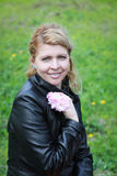 Blonde woman with pink flowers Royalty Free Stock Photography