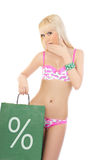 Blonde woman in pink lingerie holding shopping bag Royalty Free Stock Photo