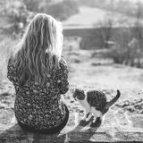 Blonde woman play with cute cat Royalty Free Stock Photo