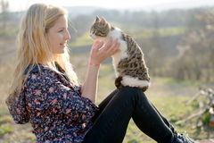 Blonde woman play with cute cat Stock Photography