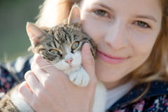 Blonde woman play with cute cat Stock Photo