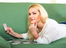 Blonde woman playing cards Stock Photography